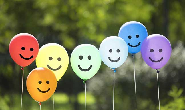 Balloons with smiling faces on them